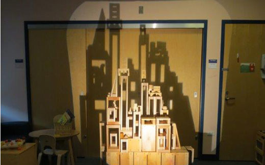 Wooden castle casting shadow