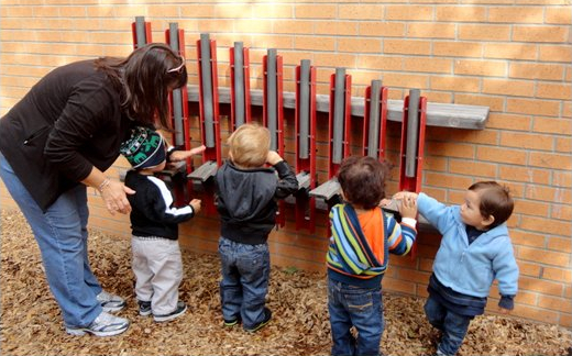 Children exploring instrument